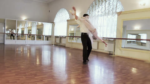 Professional dancers practicing ballet moves in studio, slow-mo Footage