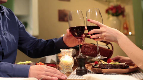Couple clinking wine glasses in restaurant, romantic dinner Footage