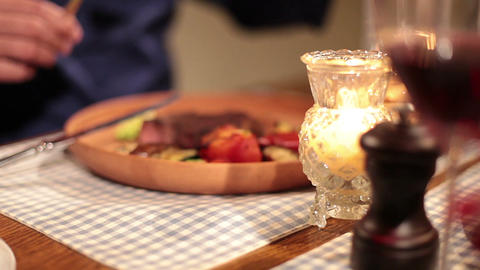 Couple eating grilled steak and drinking wine in restaurant Footage