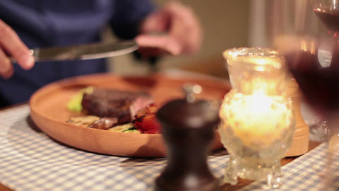 Elegant man eating grilled meat and drinking wine in restaurant Footage