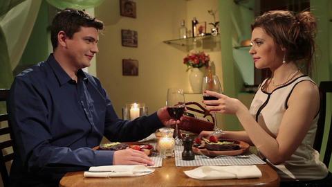 Romantic date, young attractive couple having candlelight dinner Footage
