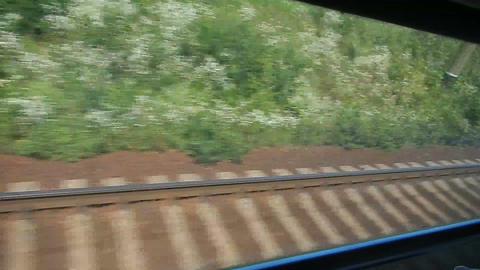 Looking through the window of fast-moving train, railway road Footage