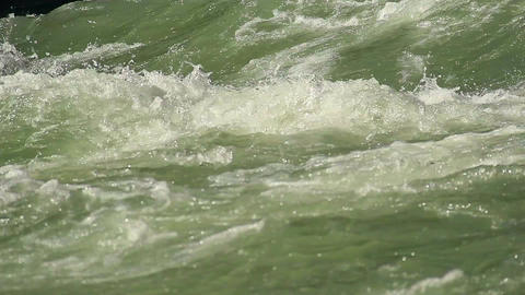 Close-up green water whirlpool, mountain torrent flowing rapidly Footage