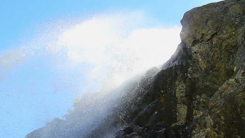 Water splashing over the rock, mountain waterfall, low angle Footage
