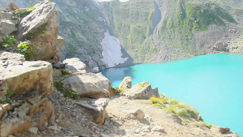 Zoom out clear blue water of mountain lake, majestic scenery Footage