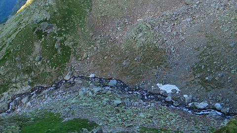 Beautiful mountain river flowing down the slope, view from above Footage