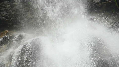 Waterfall close-up, turbulent stream splashing against the rocks Footage