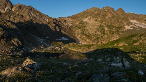 Sun rising in mountains, time-lapse, beautiful lake scenery Footage
