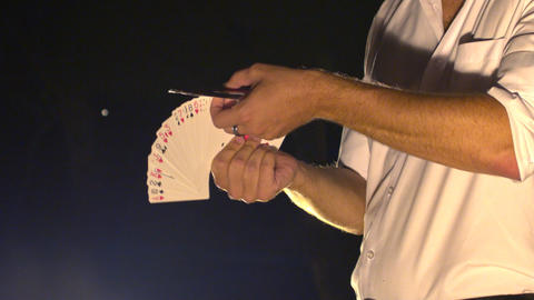 Closeup Side View Conjurer Hands Shuffle Cards into Fan Footage
