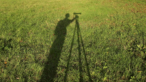 Silhouette of photographer with camera on tripod Footage