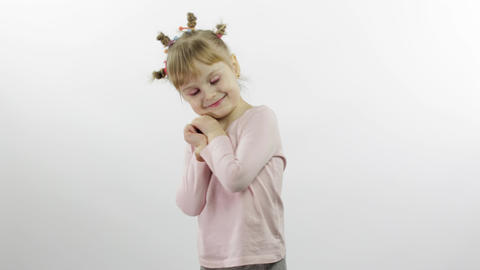 Positive girl in pink blouse dancing. Happy four little child. White background Live Action