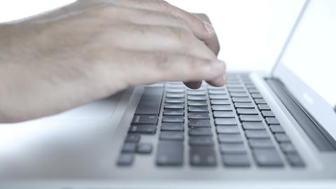 Close up hands of businessman working on laptop in office Live Action