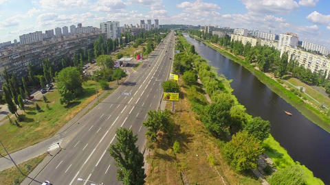 City road with cars, beautiful river, aerial view from drone ビデオ