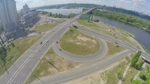 Bridge over river, road junction, car traffic aerial perspective Footage