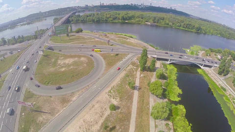 Aerial shot of bridge over river, road junction car traffic Footage