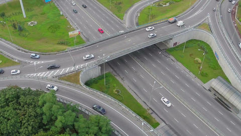 Busy city highway, overpass, fast-driving cars view from above Footage
