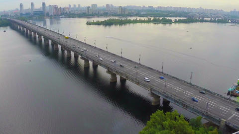 Aerial view of bridge across beautiful river, heavy car traffic Footage