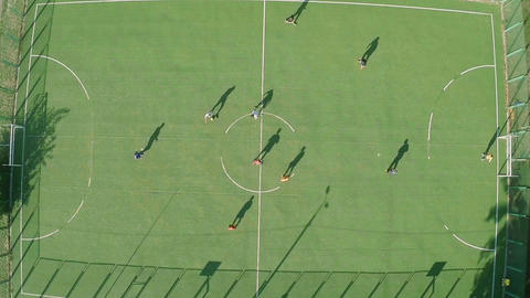 Aerial vertical shot, people playing football (soccer) on pitch Footage