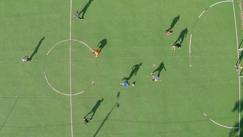 Young people playing football (soccer) having rest. Aerial shot Footage