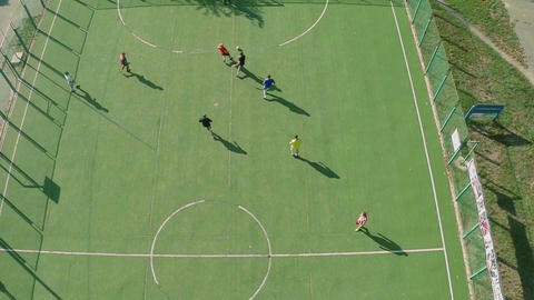 Aerial view of school college team playing football, active rest Footage