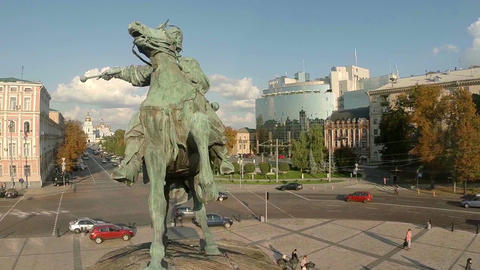 Circling around statue of man on horse, city architecture aerial Footage