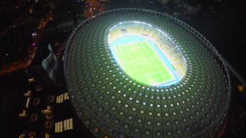 Aerial view of night city and large stadium, football match Footage