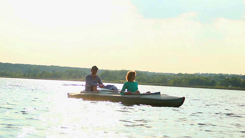 Relaxed couple sitting peacefully in boat. Rest after exercise Footage