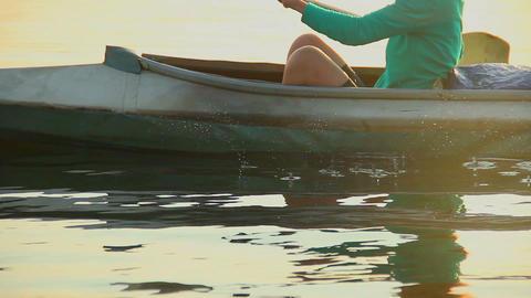 Girl tourist kayaking in high speed at sunset, beautiful nature Footage