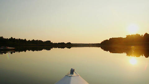 Peaceful view of beautiful sunset on river, riding a boat Footage