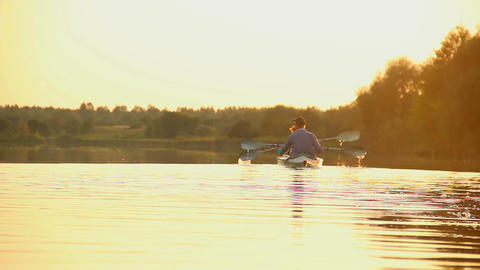 Active couple kayaking at sunset. Healthy way of living, sport Footage