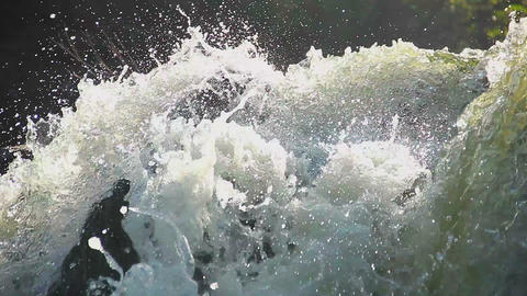 Heavy water torrent running rapidly downhill, splashes closeup Footage