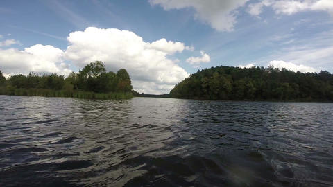 Beautiful river landscape, green nature, clouds, boating POV Footage