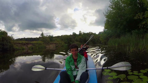 Two young men paddling canoe. Active rest, vacation, tourism Footage