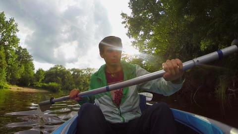 Handsome smiling man kayaking, action camera, summer, tourism Footage