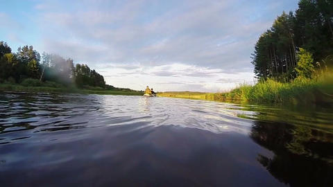 Tourists paddling canoe, action camera, underwater. Slow motion Footage