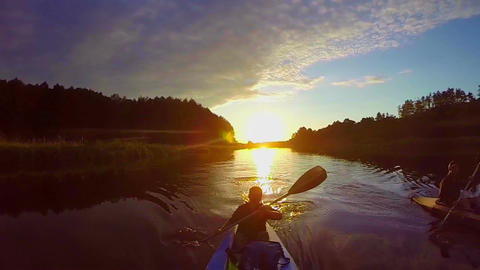 Travelers kayaking at sunset, breathtaking view, sport, slow-mo Footage