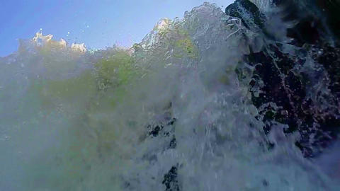 Turbulent water flowing over the rocks, low angle. Drowning POV Footage