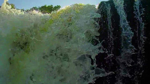 Turbulent waterfall, low angle. Submerging, accident, slowmotion Footage