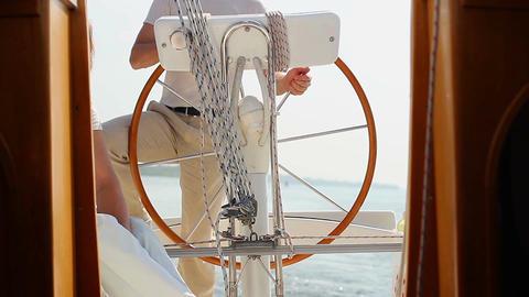Captain holding steering wheel on bridge. Yachting, sailing Footage