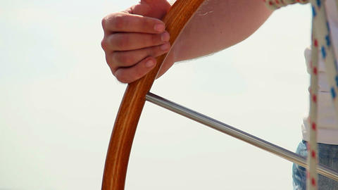 Closeup male hands on boat steering wheel, yachting, sailing Footage