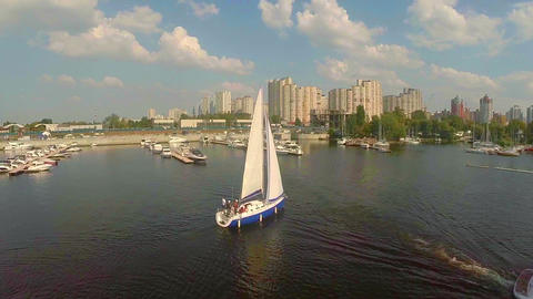 Aerial shot, sailing yacht on city river, small harbor, yachting Footage