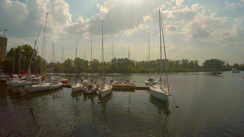 Sailboats in small city port. Yacht maintenance, repair, docks Footage