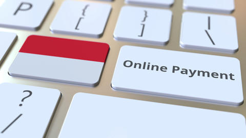 Online Payment text and flag of Indonesia on the keyboard. Modern finance Live Action