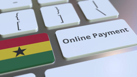 Online Payment text and flag of Ghana on the keyboard. Modern finance related Live Action