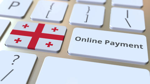 Online Payment text and flag of Georgia on the keyboard. Modern finance related Live Action
