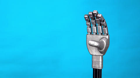 A mechanical arm flexes fingers. Gray cyborg arm came to life and began to move Live Action