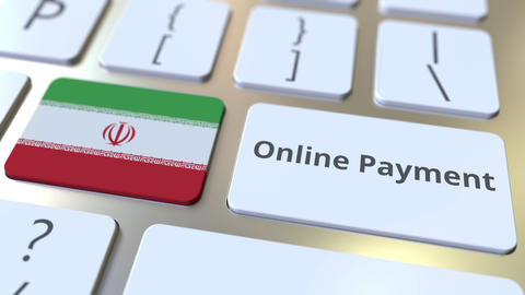 Online Payment text and flag of Iran on the keyboard. Modern finance related Live Action