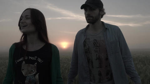 A couple of guy and girl at sunrise. Date. Romance. Love. Relations. Slow motion Live Action