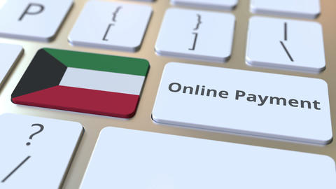 Online Payment text and flag of Kuwait on the keyboard. Modern finance related Live Action