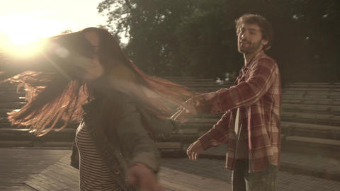 A guy and a girl are dancing at dawn. Slow motion. Couple. Relations. Romance Live Action